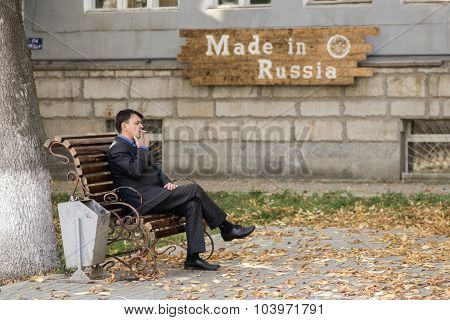 Man In Suit Smoking In Russia