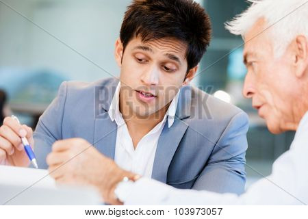 Two businessman in office having discussion