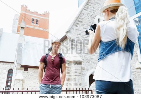 Young man in city posing for a photo