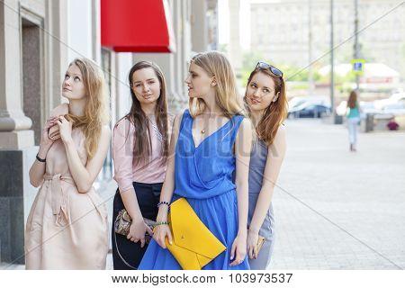 Portrait of a beautiful young four fashion women walk on summer city