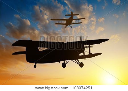 engine airplane flying at sunset