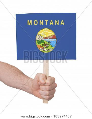Hand Holding Small Card - Flag Of Montana