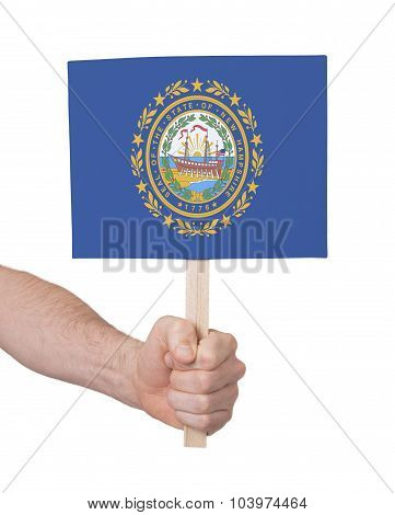 Hand Holding Small Card - Flag Of New Hampshire