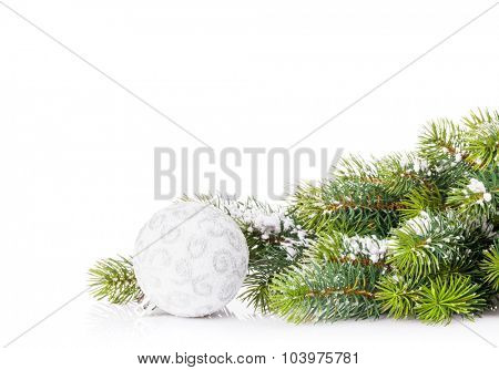 Christmas tree branch with snow and bauble. Isolated on white background with copy space