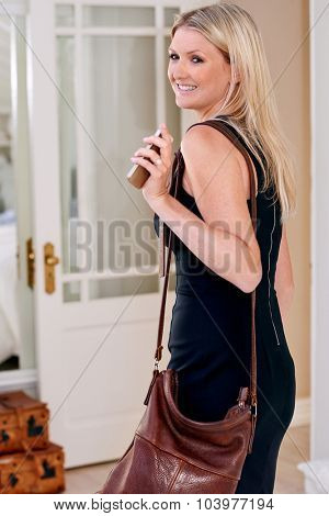 woman heading off to work waving goodbye to man
