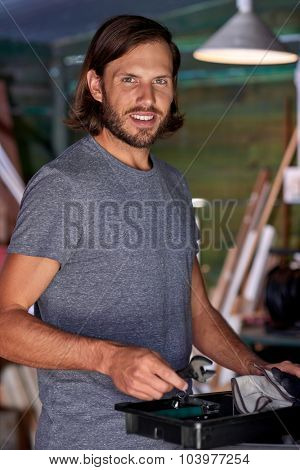 portrait of DIY man in his tool shed home workshop