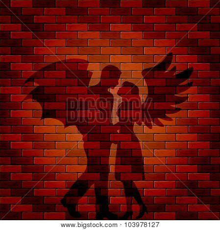 Shadow Of Angel And Demon On Brick Wall