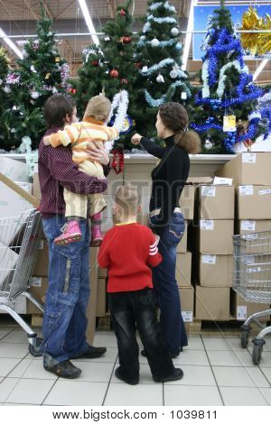 Family In Christmas Shop