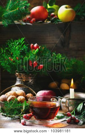 Cup Of  Briar Tea On A Christmas Rustic  Background.