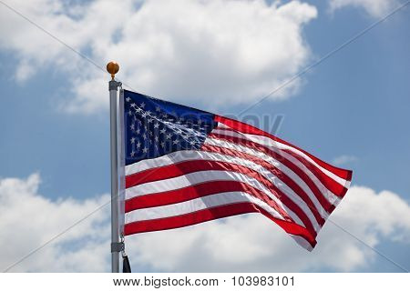 American Flag Against Blue Cloudy Sky