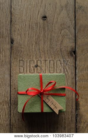 Plain Green Gift Box With Red Ribbon And Vintage Style Christmas Tag
