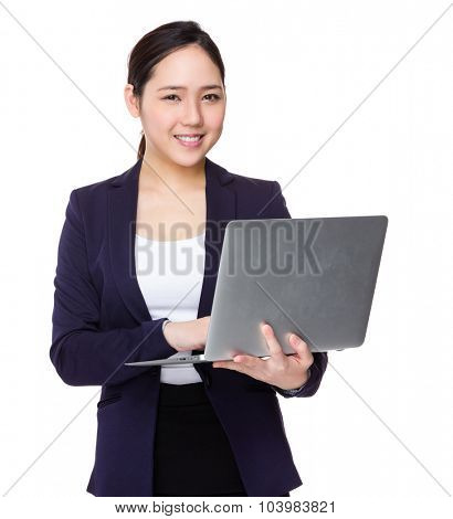 Young businesswoman use of the laptop computer
