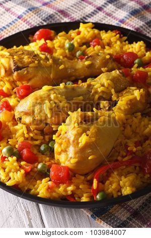 Paella With Chicken Legs And Vegetables Close-up. Vertical