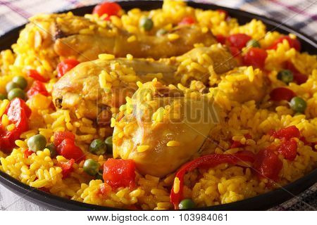 Paella With Chicken Legs And Vegetables Close-up. Horizontal