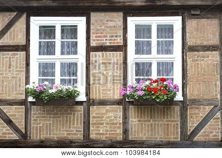 Windows on a half-timbered house in Quedlinburg town, Germany