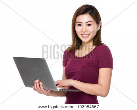 Woman use of the notebook computer