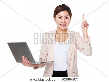 Young businesswoman use of the notebook computer and finger up