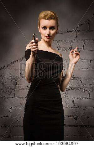 Film Noir. Retro Styled Fashion Woman With Revolver In Hand
