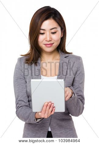 Asian Young businesswoman use of the tablet pc