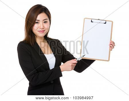 Young Businesswoman showing blank page of clipboard