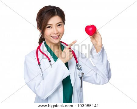 Doctor woman finger point to the heart ball