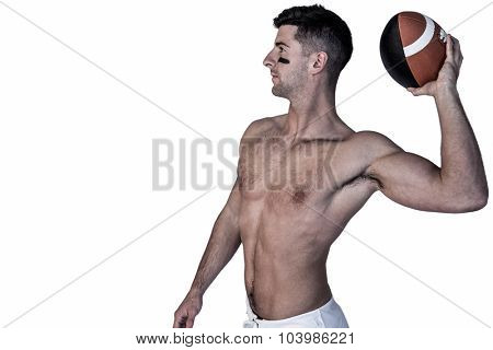 Shirtless rugby player ready to throw the ball over white background