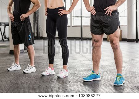 Cropped image of people at gym with hands on hip