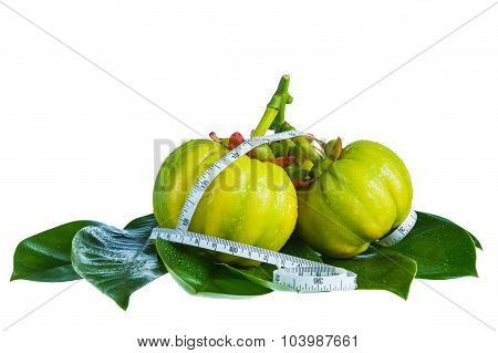 Garcinia Cambogia With Measuring Tape, Isolated On White Background.