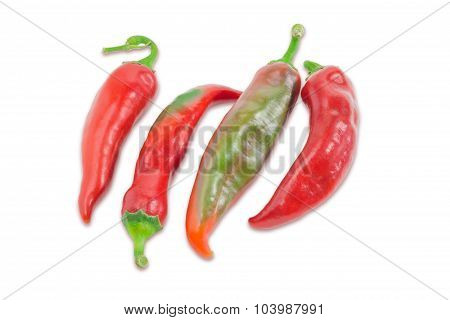 Several Red And Green Peppers Chili On A Light Background
