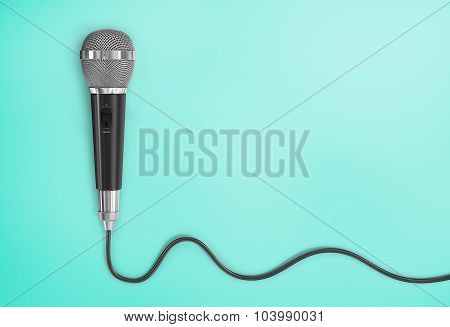 Concept Of Analog Signal. Microphone With Cord In The Form Of Analog Wave On A Blue Background.
