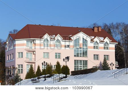 Nice apartment building with red roof at winter time