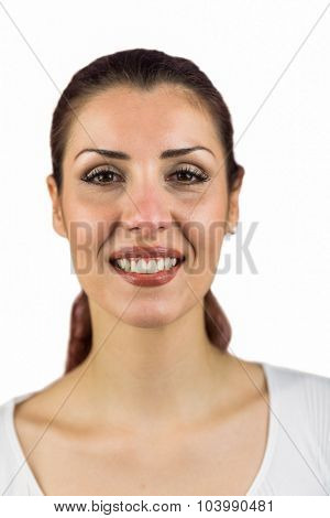 Close-up portrait of smiling woman against white background