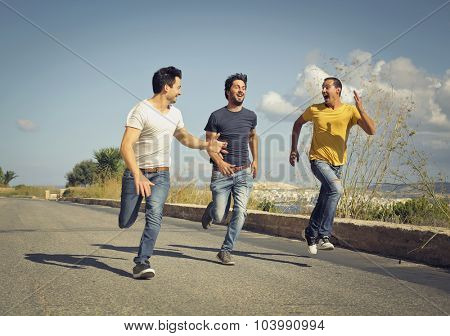 Three men running in the street