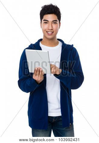 Asian young man use of the tablet pc