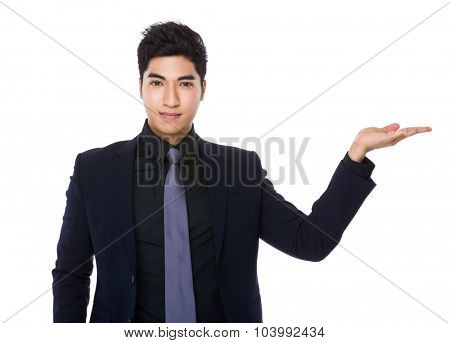 Businessman with hand showing blank sign