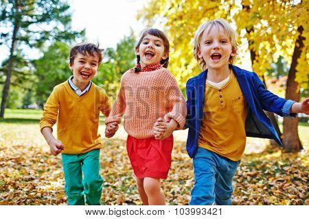 Ecstatic children looking at camera in park