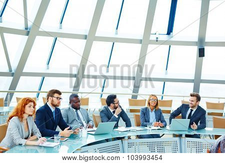 Group of young managers sitting in conference hall