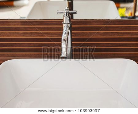 Wasting Water, Water Tap On Wooden Background