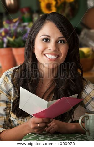 Beautiful Latina Woman With Greeting Card