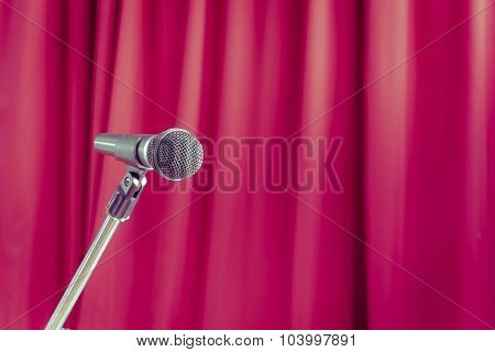 Microphone On A Stand With Blurred Red Curtain, Copyspace On The Right, Vintage Style