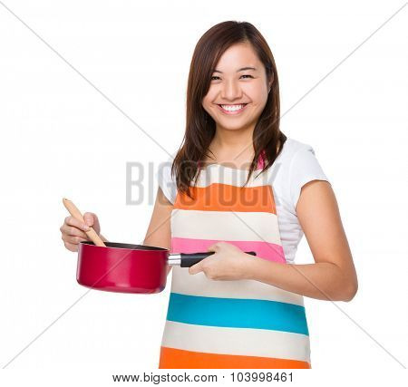 Housewife cooking with saucepan