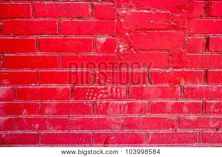 Brick wall well painted in bright red color