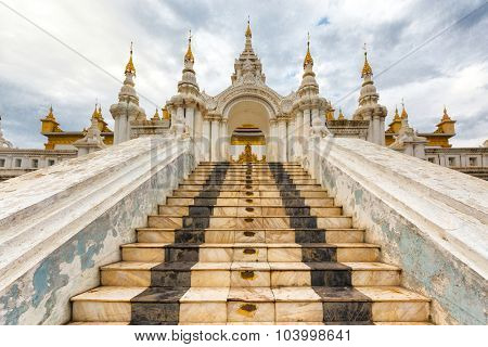 Stairs entrance of the Shwe Nan Daw wooden temple in Mandalay, Myanmar (Burma)