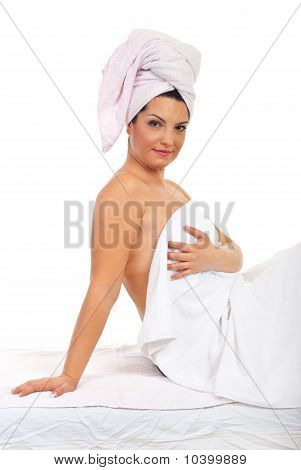 Woman  Sitting On Massage Table At Spa