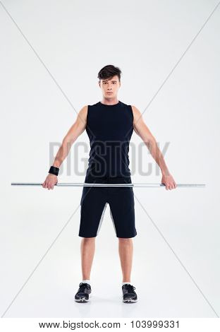 Full length portrait of a handsome fitness man workout with barbell isolated on a white background