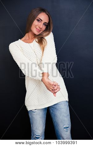 Portrait of a pretty woman standing over gray background