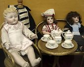 Many Antique Toy Dolls  poster