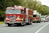 image of mustering  - fire and rescue vehicles being driven in a fire muster parade - JPG