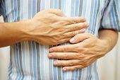 Постер, плакат: Stomach Ache Man Placing Hands On The Stomach Concept Of stomach Ulcer