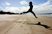 image of bribie  - A woman doing some ballet moves at Bribie Island beach - JPG